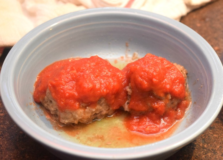 Spoon sauce over the microwave meatballs.