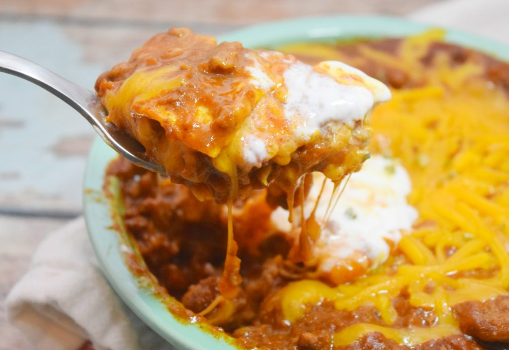 Close up of Easy Enchilada Bowl with sour cream topping.