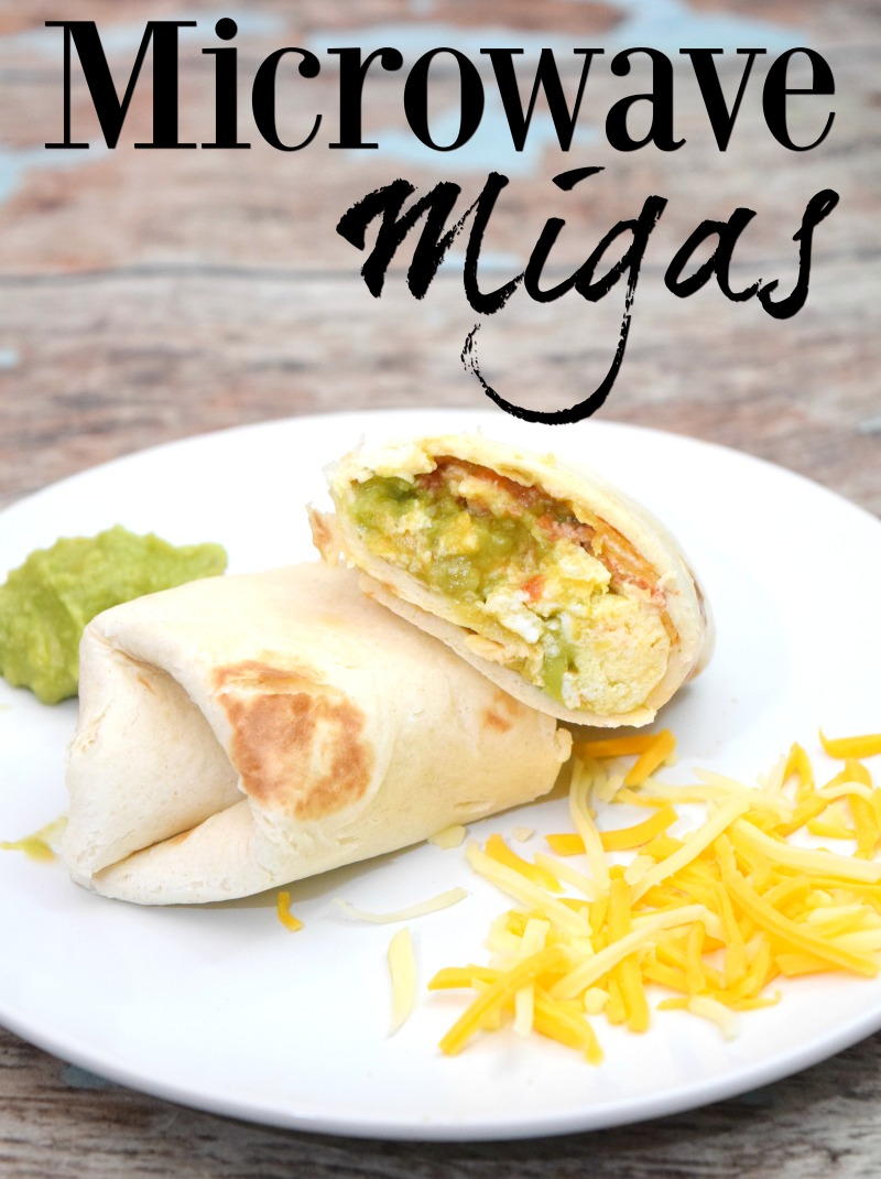 The finished version of Microwave Migas in a flour tortilla on a white plate.