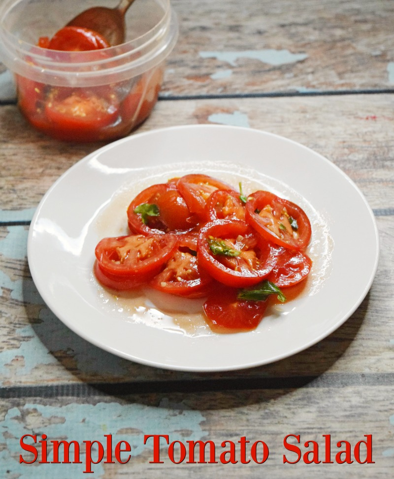 A full plate of a simple tomato salad with balsamic vinegar, oil, and basil.