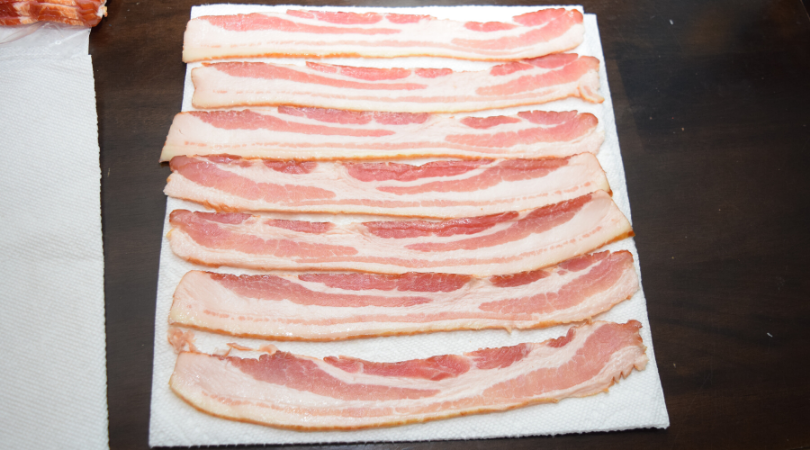 lay out 5-6 pieces of bacon in rows not touching to cook in the microwave