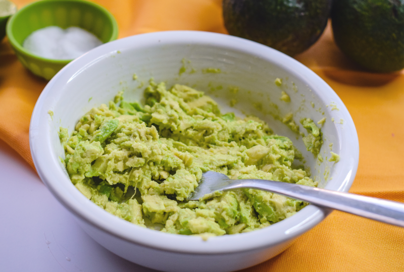 Mash and mix your avocados to make super simple guacamole