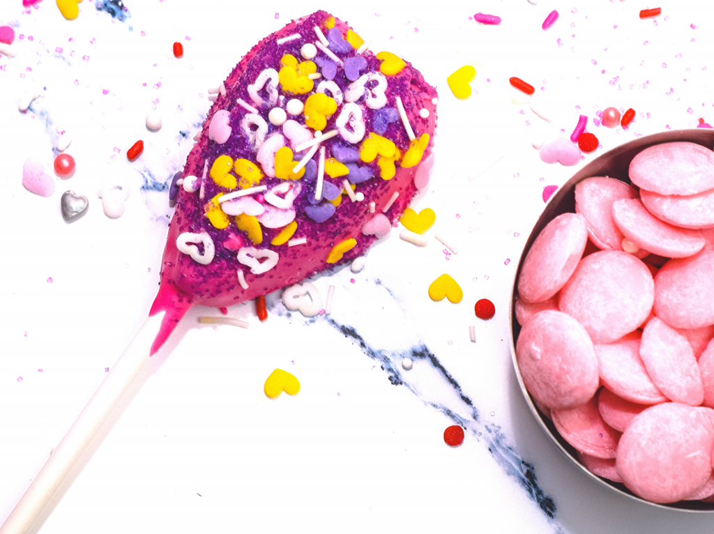 A Heart on a Stick made with pink candy melts and sprinkles