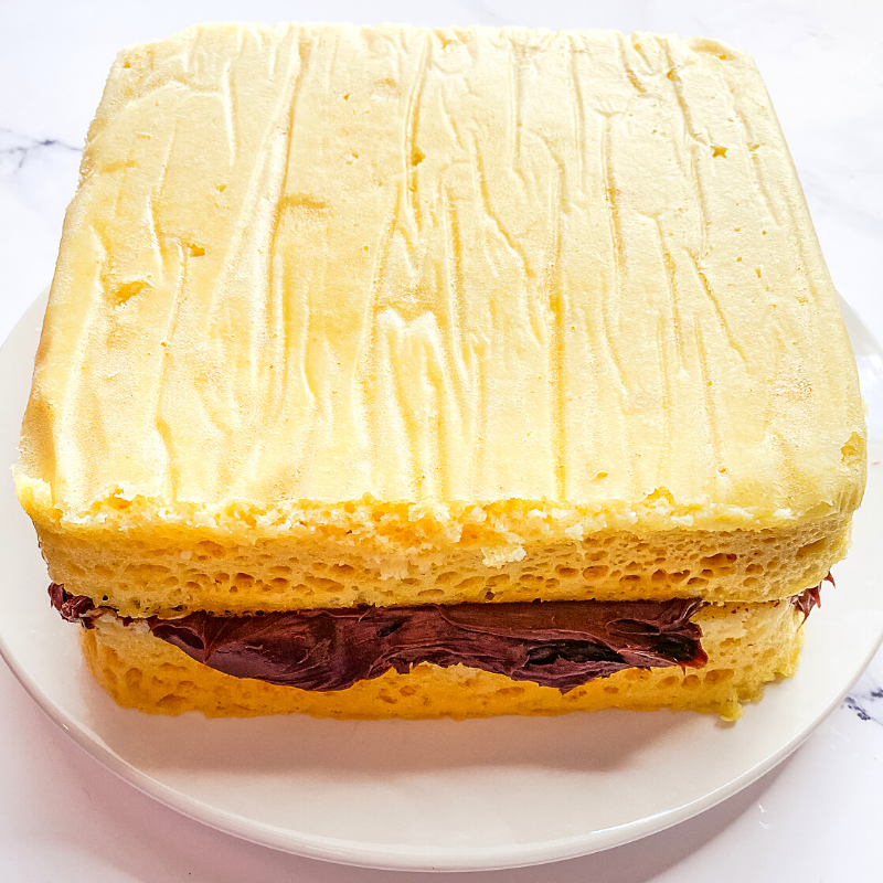 The layer cake on top of each other with a big layer of frosting in between