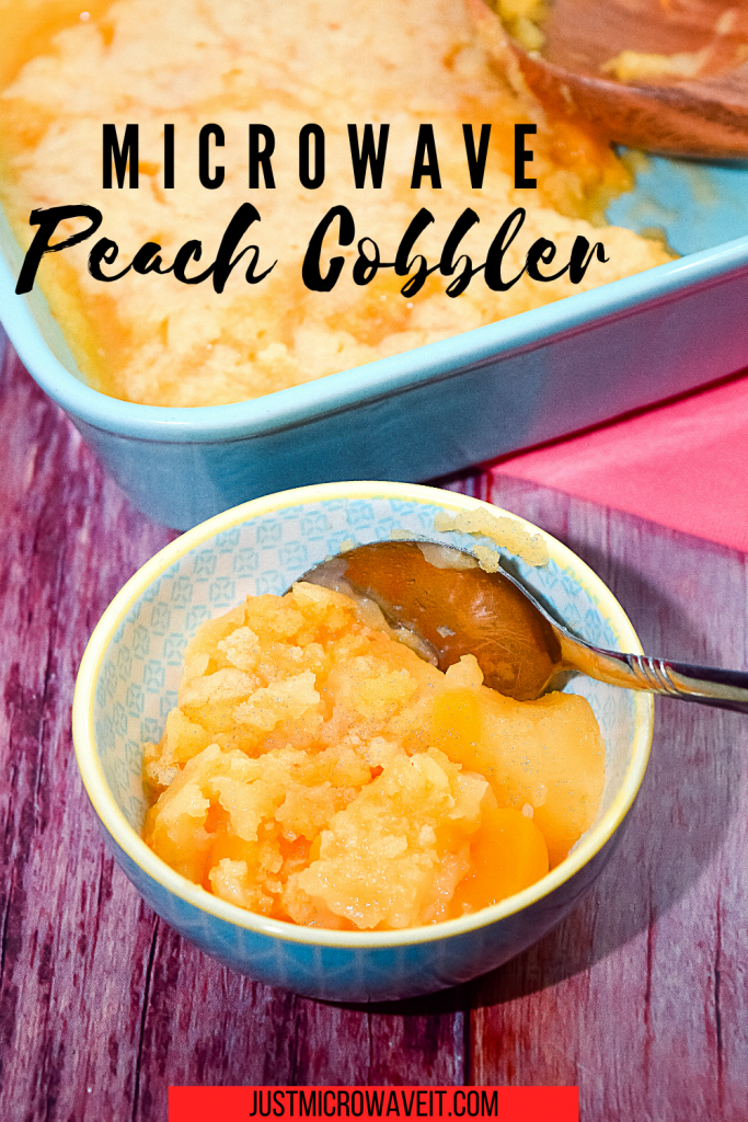 In the foreground is a small bowl of peach cobbler with a metal spoon.  In the background is a partial view of the microwave peach cobbler in a blue baking dish.