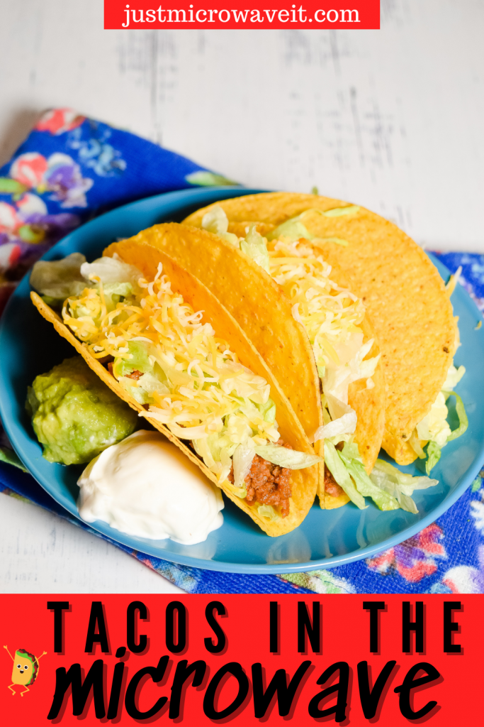 Title image of beef tacos in the microwave with a blue floral towel on a white background with a blue plate with 2 beef tacos and a scoop of sour cream and a scoop of guacamole