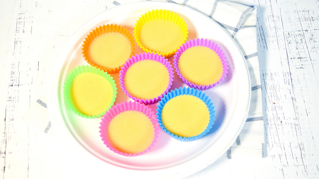 Yellow cupcake batter in silicone cupcake liners.
